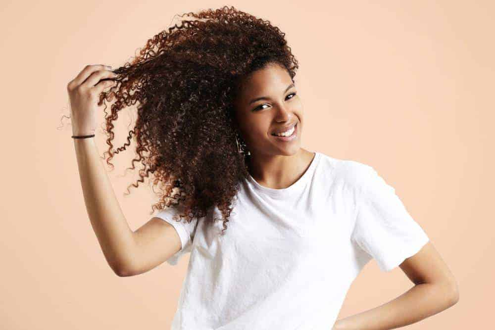 Cute female with curly hair wearing a white t-shirt