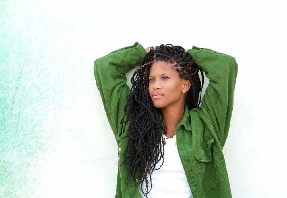 black women wearing goddess braids locs and green shirt