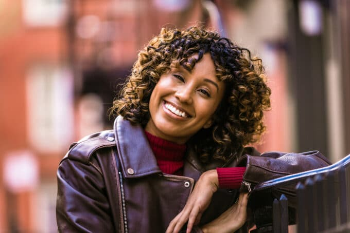 African American female with a sweet smile and 4b curls