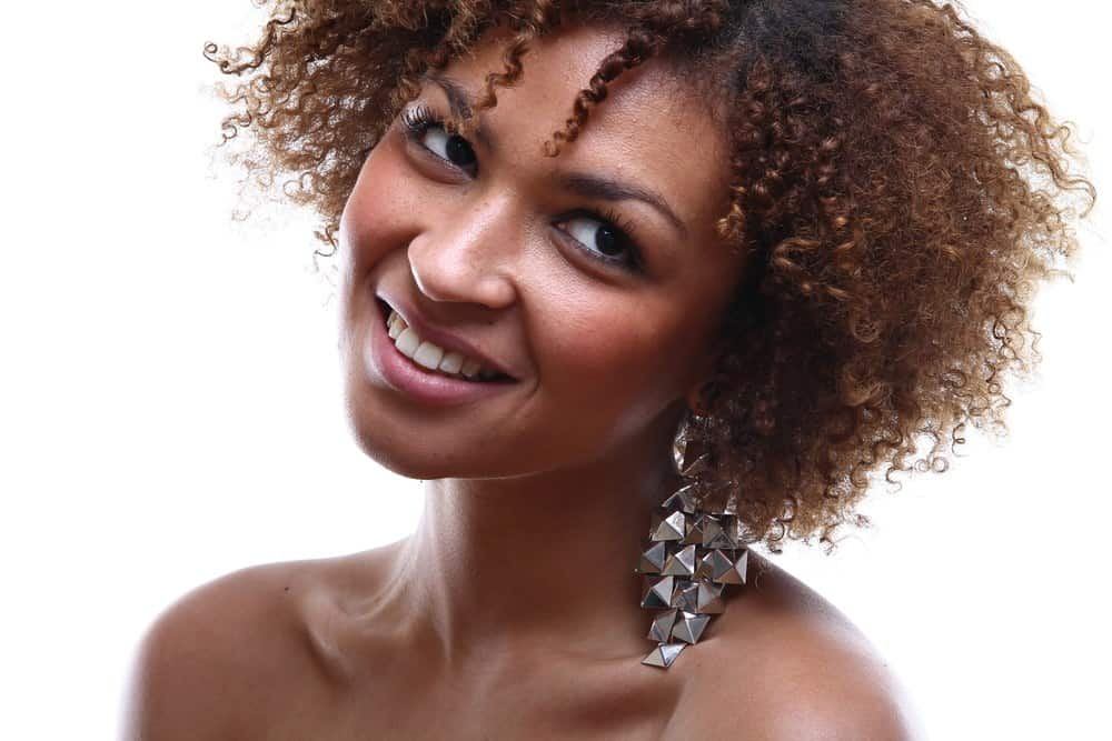Cute black girl wearing a silver hair clips with type 3c curly hair.
