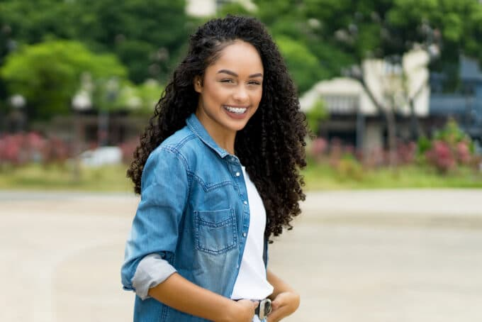 African American female with naturally curly type 3c hair.