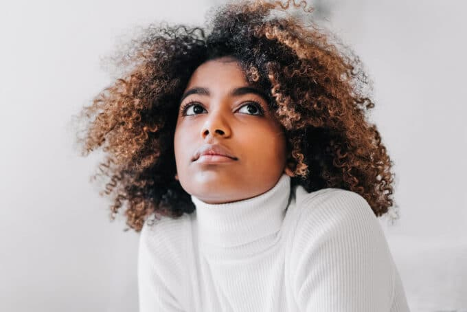 Black women with type 4b curly hair that been dyed brown and black after being detangled.