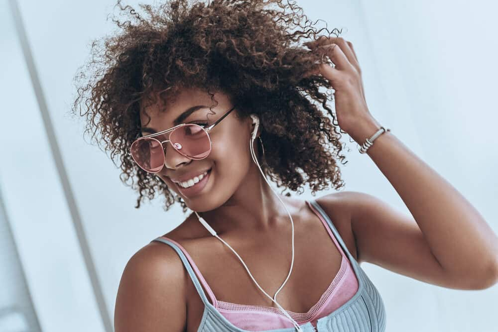 Cute black girl photo after taking advantage of goat milk benefits for hair growth.