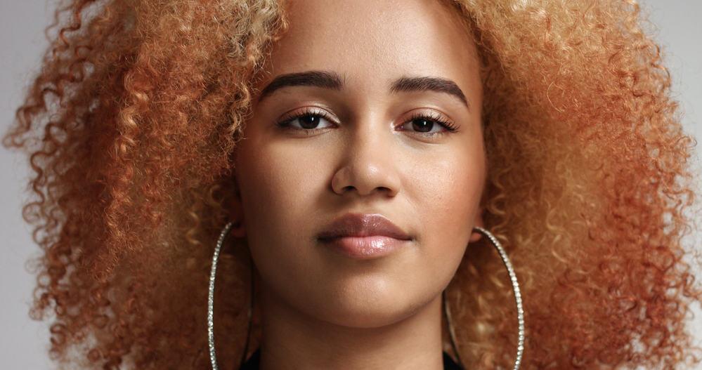 Confident black women with reddish-blonde hair and huge hoop earrings providing full shock value