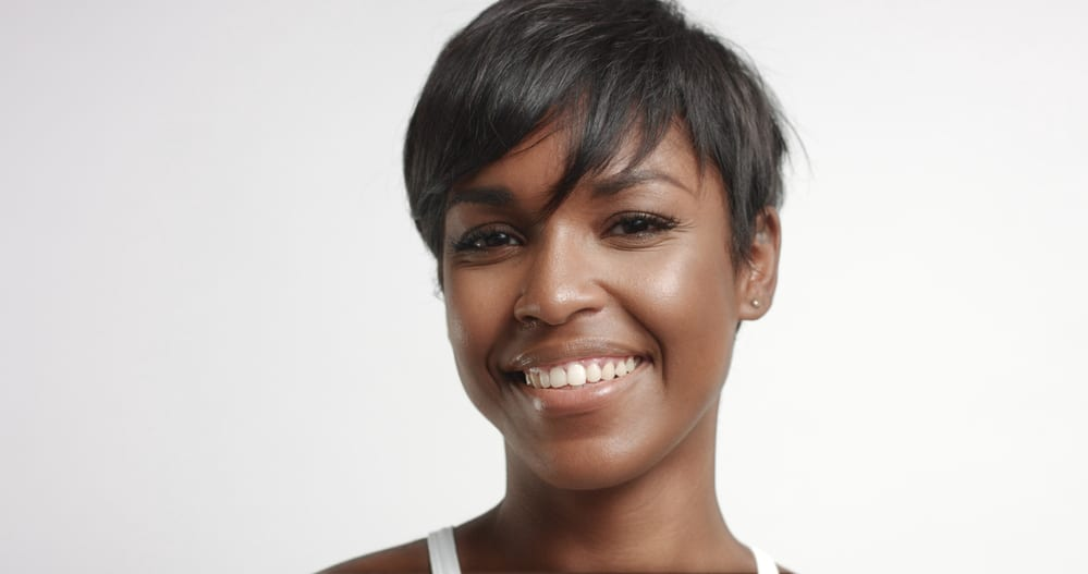 African American female with a silk wrap hairstyle on natural hair with a great smile.