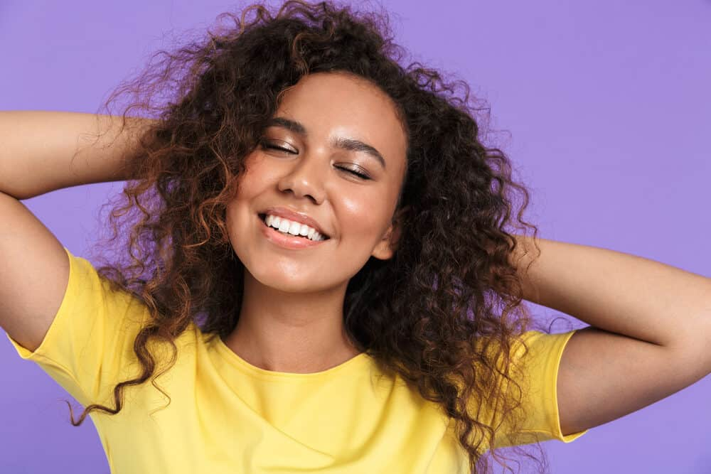 African American women with 3c curly hair strands with warm purple overtones