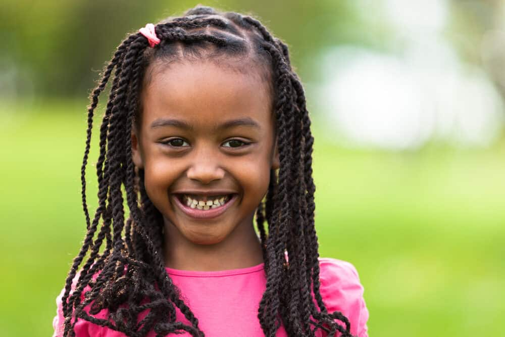 Young African American little girl with 4a hair texture with braided long hair