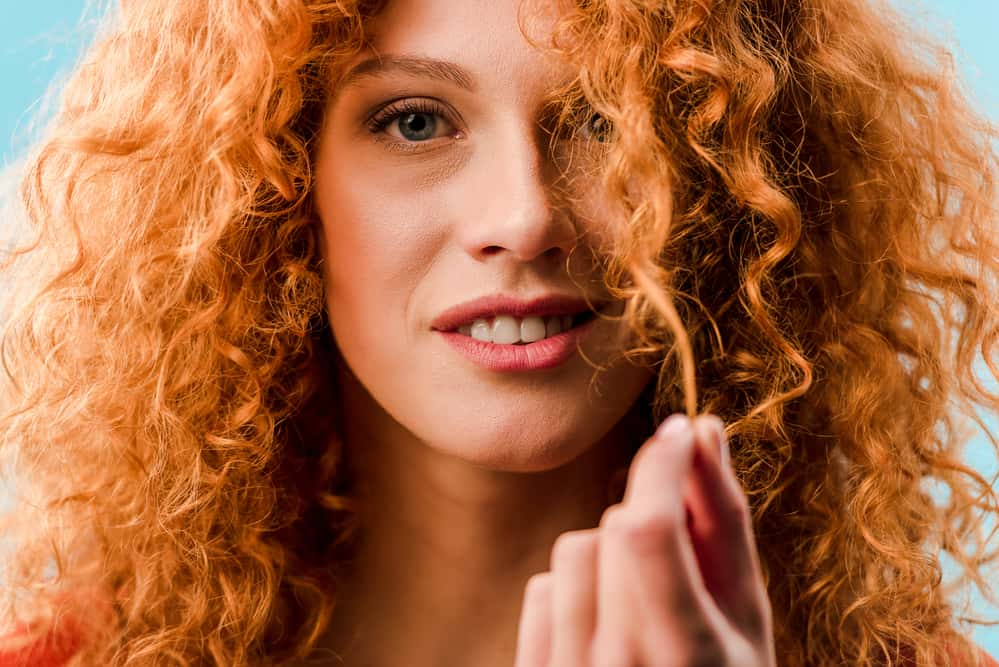 Close-up of white female with 2c wavy hair with redhead gene.
