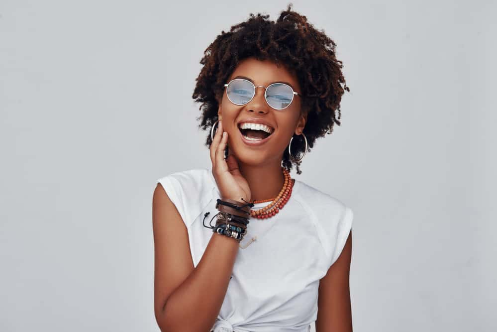 Black with a big smile wearing natural hair with severe tangles