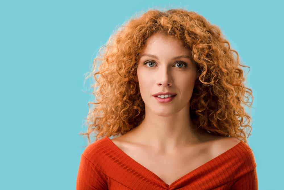 Pretty caucasian red head women with pale skin, blue eyes, and the ginger gene.