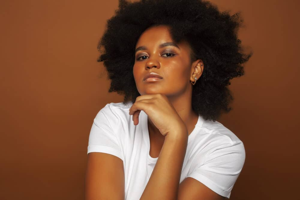 African American female with 4c naturally curly hair without any chemical treatments.