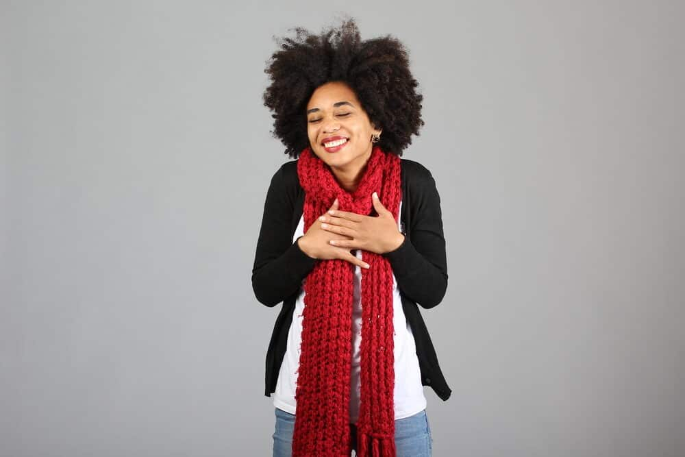 African American female with 4c kinky, naturally curly hair.
