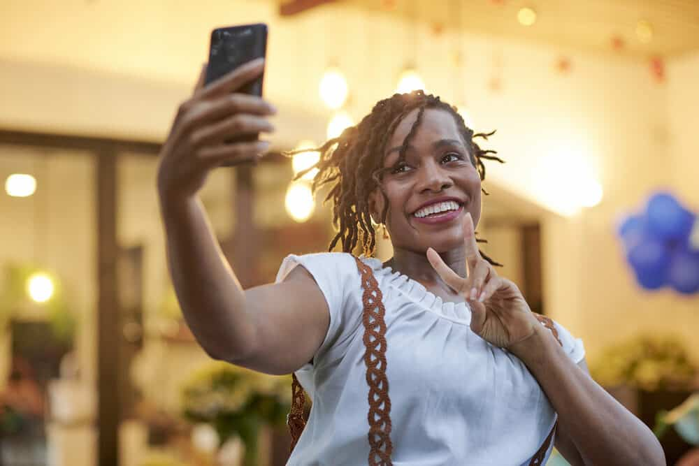 Women taking a selfie with a phone at an outdoor mall at World Market.