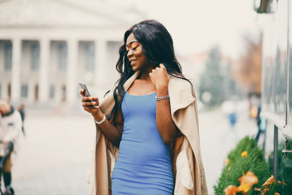 African American female wearing a blue dress with long black hair
