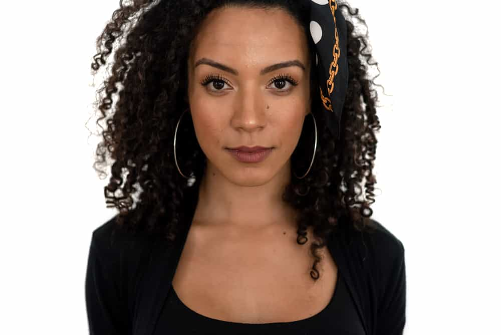 Black woman with low porosity hair posing after using the LCO Method