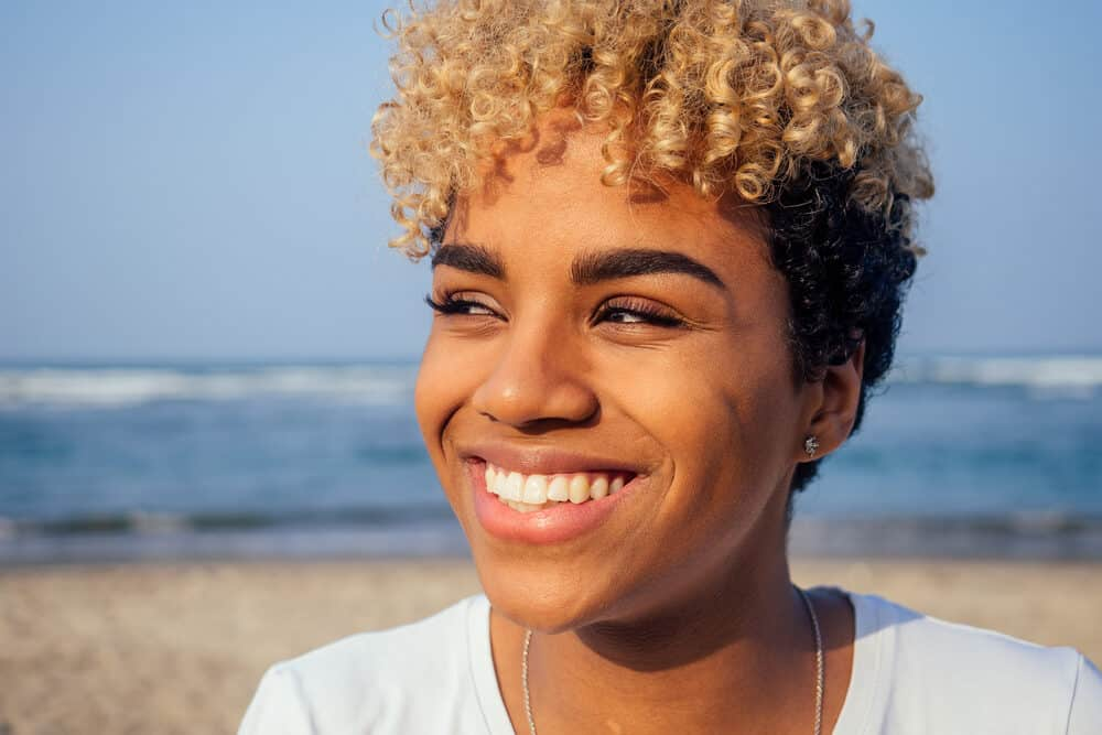 Afro-Latin American woman with perfect skin soaking up the UV rays while she enjoys the beach