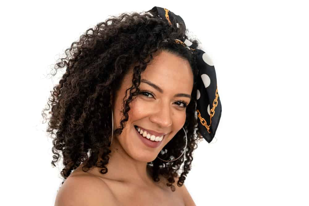 Black woman with 4A curls after using the natural hair LCO method to keep your hair moisturized