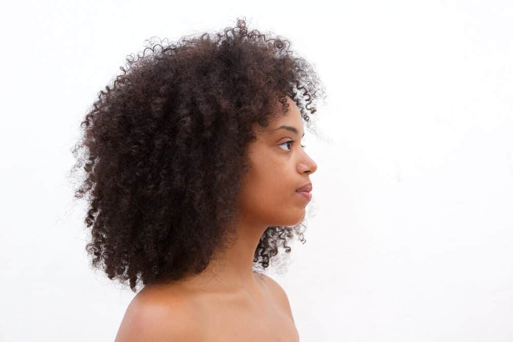 Curly girl with type 4A curl pattern wearing a Rezo Cut from the Devachan Salon.