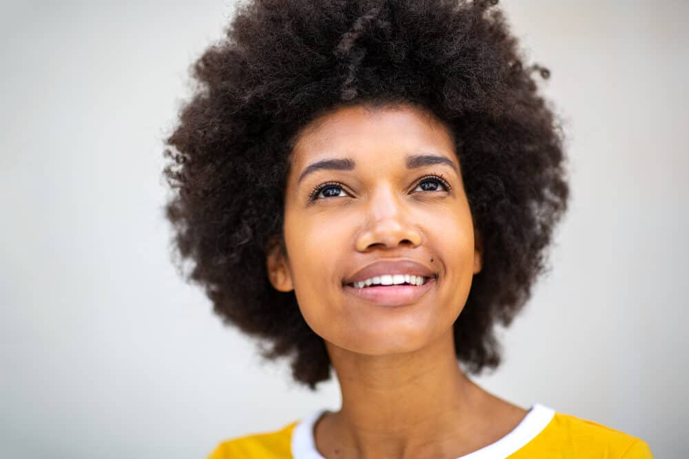 African American female with a 4C hair type showing off her well-defined curls.