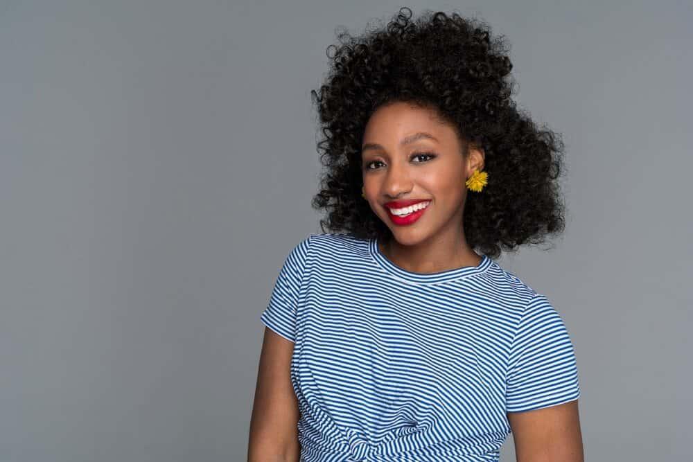 Black lady wearing the darkest shade 1B weave hair extensions