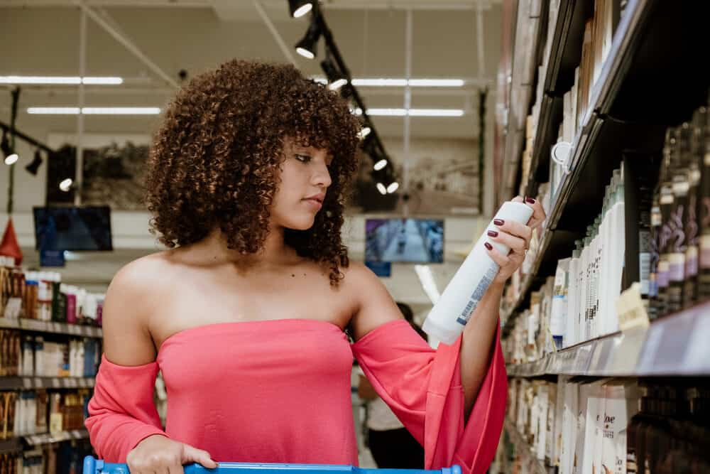 Black woman with curly hair that smells lovely searching for her usual shampoo