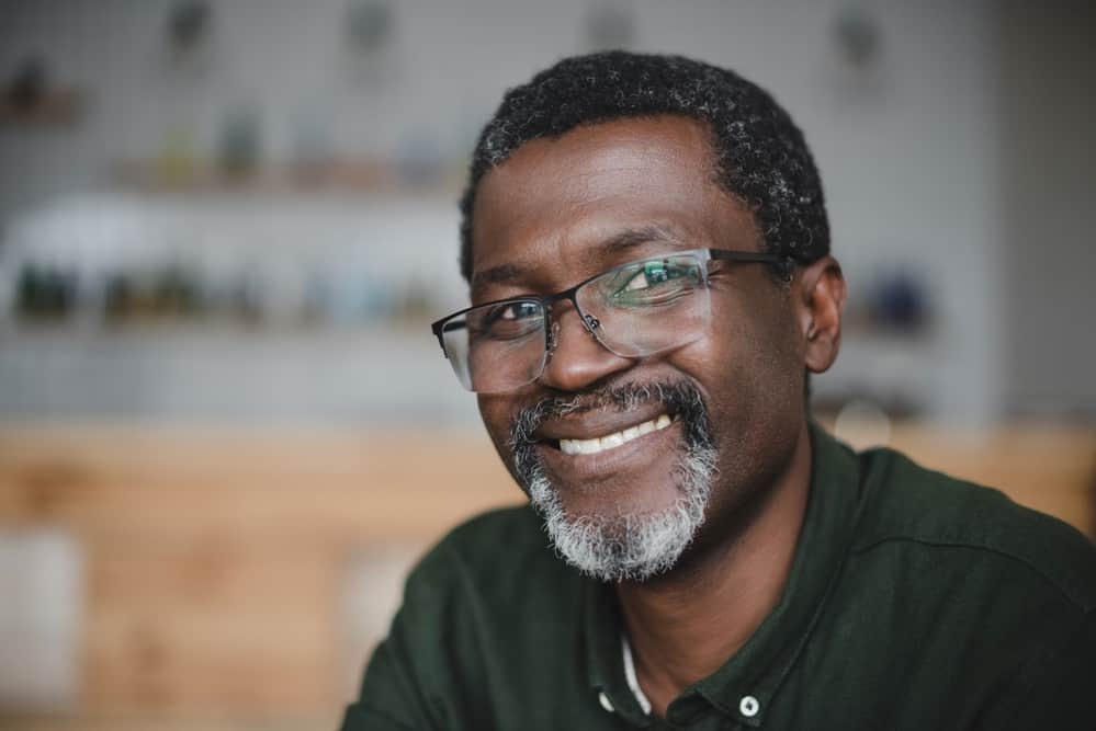Older black man with short afro hair - the most dominant hair type among African American males.