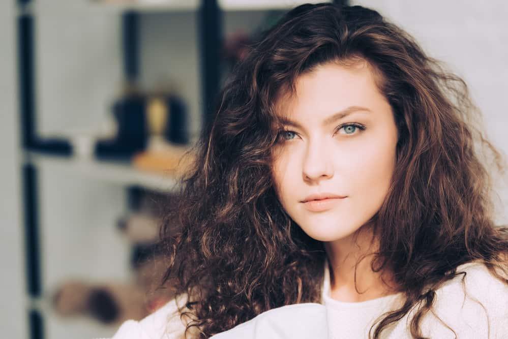 Female with natural Caucasian hair strands (also called European hair)
