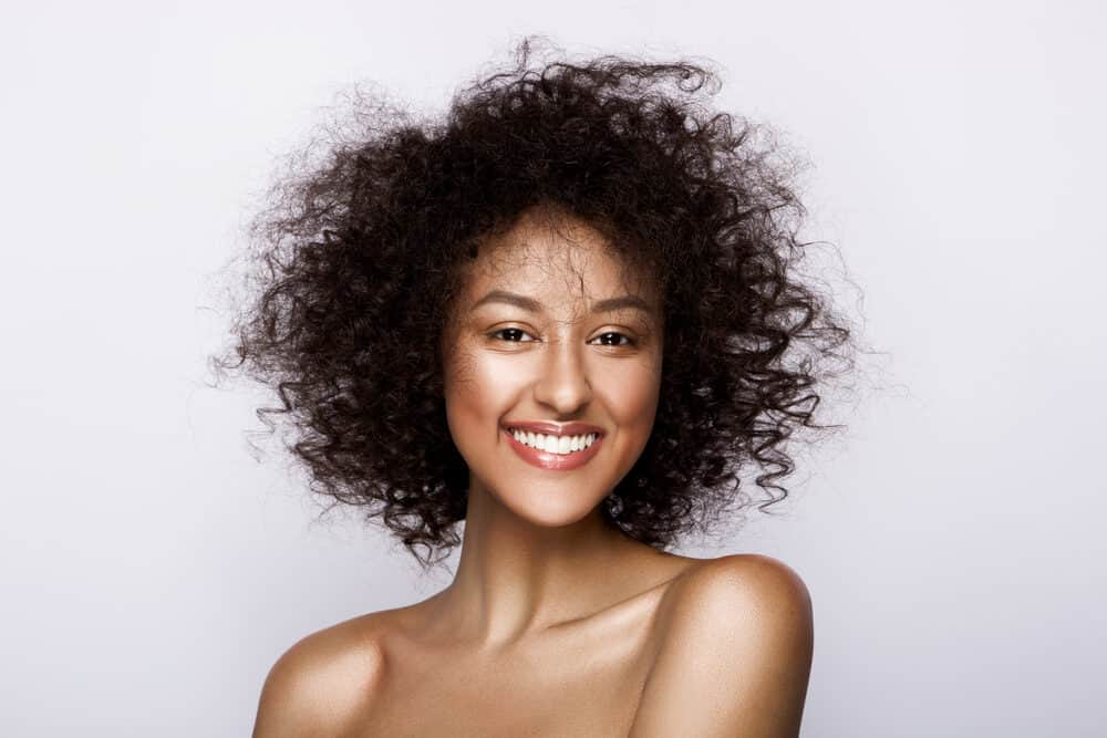 Cute African American female with type 3 curly hair strands