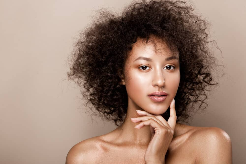 Beautiful African American woman with shoulder-length healthy hair and caramel skin