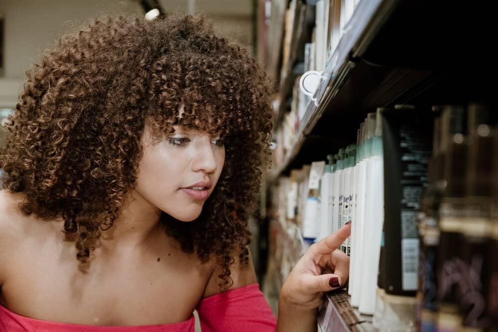 African American female searching for Garnier Fructis Sleek in Target