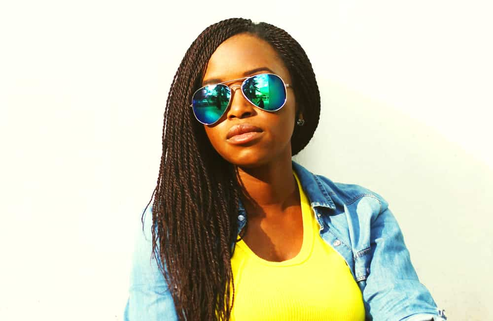 Black woman with healthy hair in crochet braids which is a protective hairstyle