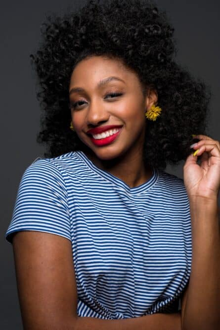 Cute African American female with natural black hair color