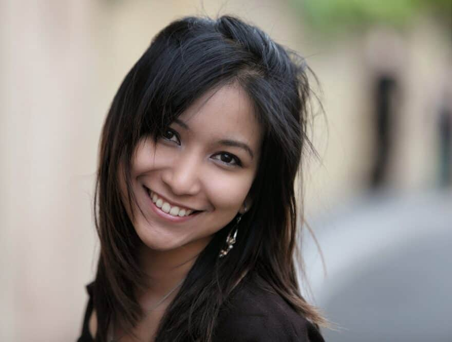 Young Asian woman with dense hair and more strands per hair diameter than any other ethnic group